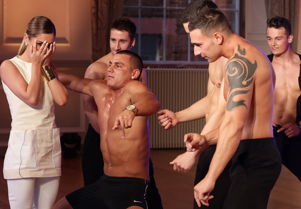 Cheryl Cole looks mortified as strippers do their thing at X Factor