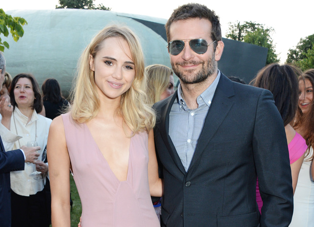 LONDON, ENGLAND - JULY 01: Suki Waterhouse (L) and Bradley Cooper attend The Serpentine Gallery Summer Party co-hosted by Brioni at The Serpentine Gallery on July 1, 2014 in London, England. (Photo by David M. Benett/Getty Images for The Serpentine)