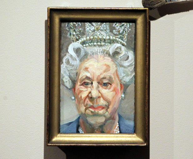 Curator Lauren Porter dusts a portrait by Lucian Freud of Queen Elizabeth II as part of the exhibition The Queen: Portraits of a Monach being shown at Windsor Castle. Picture date: Tuesday November 20, 2012. Photo credit should read: Steve Parsons/PA Wire Ref #: PA.15184001
