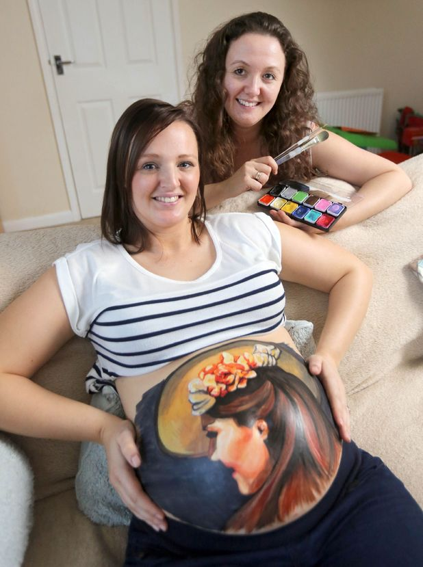 Pregnant woman has image of Catherine Duchess of Cambridge painted on her stomach, Cornwall - 03 Jan 2013Mum-to-be Katie Lutey with a portrait of the Duchess of Cambridge painted on her baby bump and artist Nicola Shilson 3 Jan 2013
