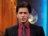 Shah Rukh Khan poses for a photograph during an appearance on a television show in Mumbai