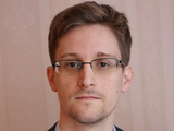 Edward Snowden poses for a photo during an interview in an undisclosed location in December 2013 in Moscow, Russia