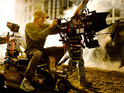 Michael Bay takes aim at Transformers critics, asking them to see the films with audiences.