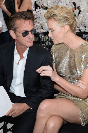 PARIS, FRANCE - JULY 07: (L-R) Sean Penn and Charlize Theron attend the Christian Dior show as part of Paris Fashion Week - Haute Couture Fall/Winter 2014-2015 on July 7, 2014 in Paris, France. (Photo by Pascal Le Segretain/Getty Images)