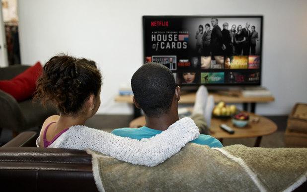 A couple watching Netflix