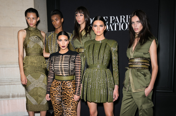 PARIS, FRANCE - JULY 09: (L-R) Balmain Army models Binx Walton, Ysaunny Brito, Issa Lish, Amanda Wellsh, Kim Kardashian and her sister Kendall Jenner attend the Vogue Foundation Gala as part of Paris Fashion Week at Palais Galliera on July 9, 2014 in Paris, France. (Photo by Richard Bord/WireImage)