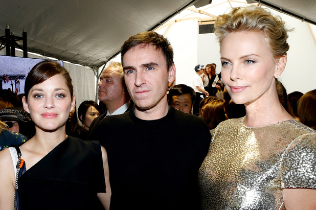 PARIS, FRANCE - JULY 07: (L-R) Actress Marion Cotillard, Fashion designer Raf Simons and Actress Charlize Theron pose backstage after the Christian Dior show as part of Paris Fashion Week - Haute Couture Fall/Winter 2014-2015. Held at Musee Rodin on July 7, 2014 in Paris, France. (Photo by Rindoff/Dufour/Getty Images)