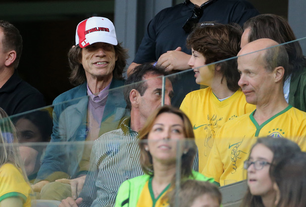 BELO HORIZONTE, BRAZIL - JULY 8: Mick Jagger and his son Lucas attend the 2014 FIFA World Cup Brazil Semi Final match between Brazil and Germany at Estadio Mineirao on July 8, 2014 in Belo Horizonte, Brazil. (Photo by Jean Catuffe/Getty Images)