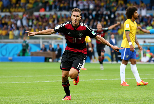 Miroslav Klose of Germany celebrates scoring his team's second goal during the 2014 FIFA World Cup semi-final match against Brazil