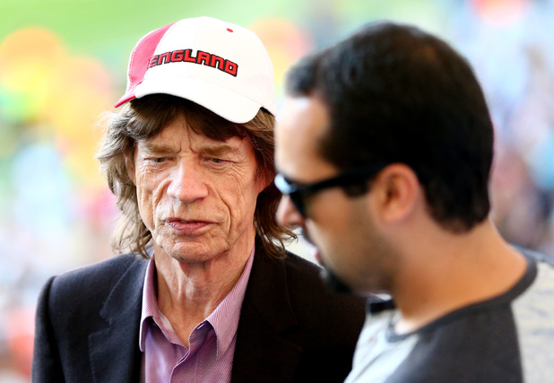Mick Jagger makes his way into the stadium for the world cup final
