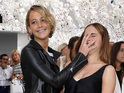 See Jennifer Lawrence plant her palm in Emma Watson's face at Paris Fashion Week.