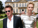 PARIS, FRANCE - JULY 07: Actors Charlize Theron (R) and Sean Penn attend the Christian Dior show as part of Paris Fashion Week - Haute Couture Fall/Winter 2014-2015. Held at Musee Rodin on July 7, 2014 in Paris, France. (Photo by Rindoff/Dufour/French Select/Getty Images)