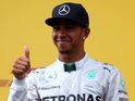 Lewis Hamilton gives a thumbs up as he celebrates on the podium after finishing second in the Austrian Formula One Grand Prix
