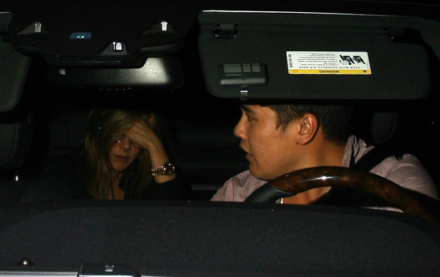 Jennifer Aniston's driver crashes her car whilst sneaking out of a restaurant in West Hollywood