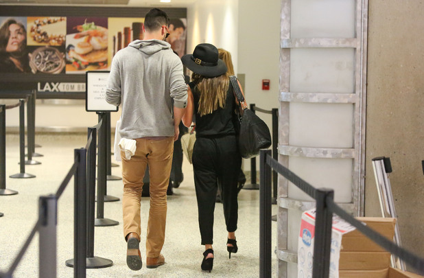 Lea Michele and Matthew Paetz hold hands at LAX airport
