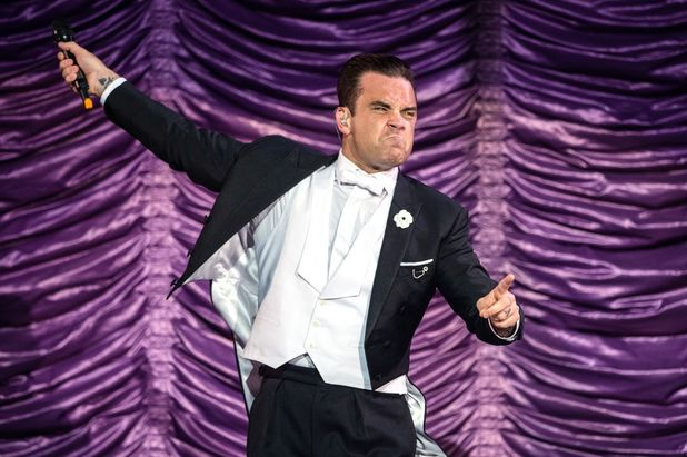 Robbie Williams performs during his Swings Both Ways Tour at the Ziggodome in Amsterdam, The Netherlands.