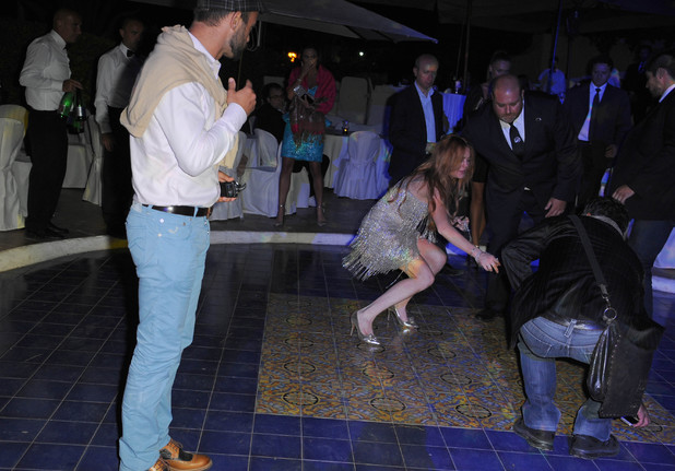 Lindsay Lohan takes a spill on the dancefloor at a Gala Dinner in Ischia Date of Picture: 07/15/2014 See the set: SPL802651 Usage: NO FRANCE, ITALY Caption: Lindsay Lohan takes a spill on the dancefloor at a Gala Dinner in Ischia.