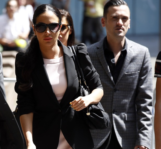 Tulisa Contostavlos with Gareth Varey outside court