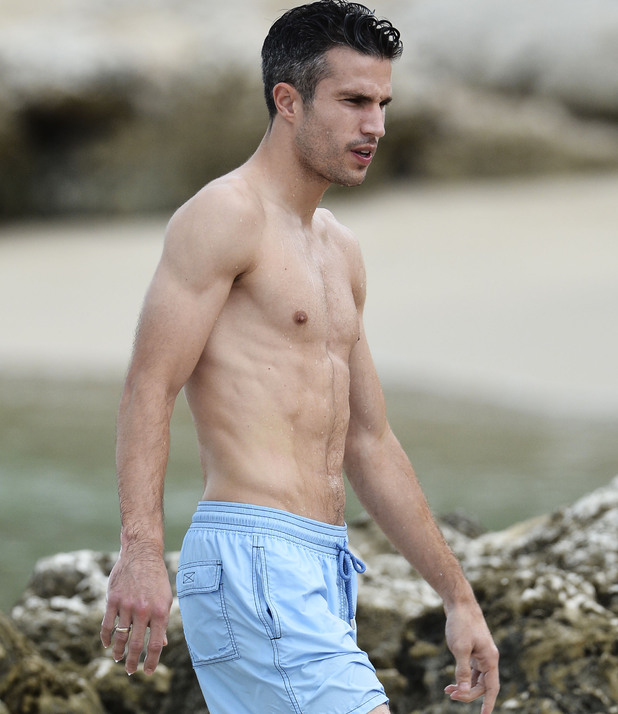 Robin van Persie and family are spotted on the beach in Barbados