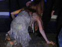 Lindsay Lohan falls over on the dance-floor at film festival gala dinner.