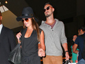 The singer and actress is seen holding hands with love interest at LAX.