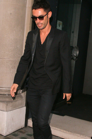 LONDON, UNITED KINGDOM - JULY 23: Jean-Bernard Fernandez-Versini seen leaving the Avenue after attending the launch of Cheryl Fernandez-Versini's new perfume 'Storm Flower' on July 23, 2014 in London, England. (Photo by Mark Robert Milan/GC Images)