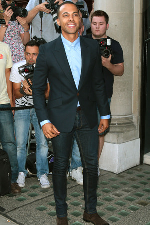 LONDON, UNITED KINGDOM - JULY 23: Marvin Humes seen leaving the Avenue after attending the launch of Cheryl Fernandez-Versini's new perfume 'Storm Flower' on July 23, 2014 in London, England. (Photo by Mark Robert Milan/GC Images)