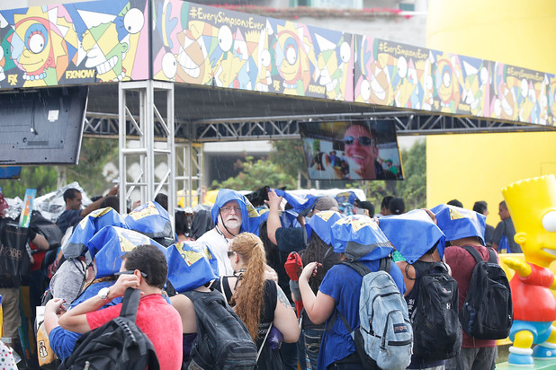 A general view of people outside in the rain at Comic-Con International 2014 - Day 4