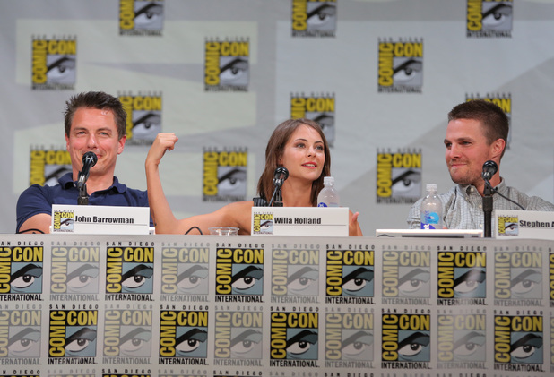 "Actors John Barrowman, Willa Holland and Stephen Amell attend the ""Arrow"" panel"