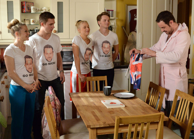 Mick receives a pair of Union Jack trunks at breakfast and sees the family wearing 'Go Mick' T shirts!