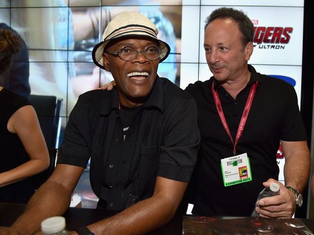 Actor Samuel L. Jackson (L) and Marvel executive producer Louis D'Esposito attend Marvel's 'Avengers: Age Of Ultron' Hall H Panel Booth Signing during Comic-Con