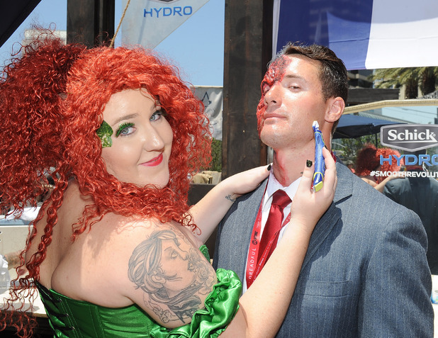Comic-Con attendees are treated to customized shaves by professional barbers at the Schick Hydro shave station at the Assassin's Creed Experience