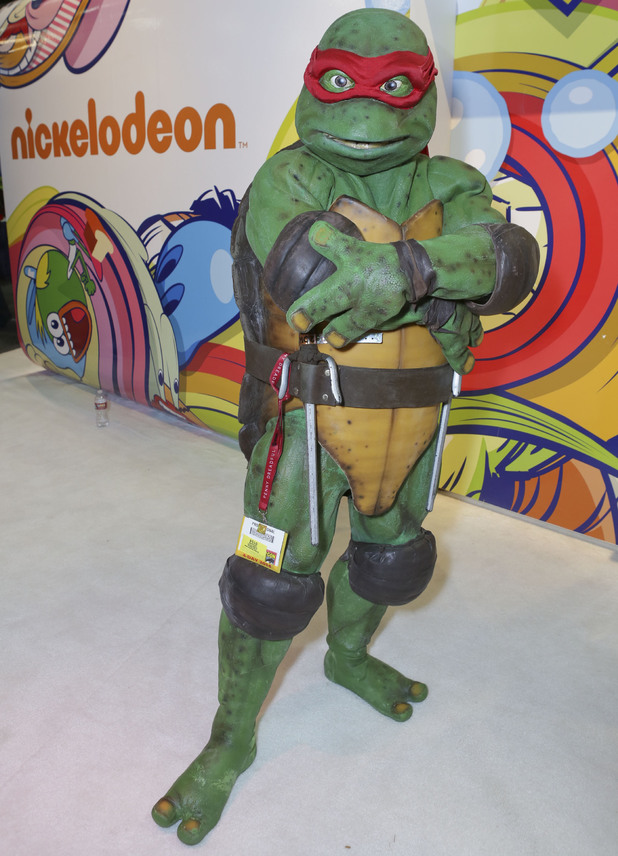 A Teenage Mutant Ninja Turtle poses at the Nickelodeon Booth at the 2014 San Diego Comic-Con