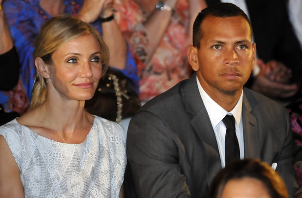 New York Yankees' third baseman Alex Rodriguez, right, and his girlfriend, U.S. actress Cameron Diaz, attends a ceremony where eight retired players were inducted to the Latin Baseball Hall of Fame in La Romana, Dominican Republic, Saturday, Feb. 12, 2010. Rodriguez received a recognition award for being the youngest Latin MLB player to pass 600 homers in his career. (AP Photo/Victor Calvo)