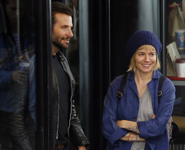 LONDON, UNITED KINGDOM - JULY 29: Bradley Cooper and Sienna Miller seen on the set of 'Adam Jones' in Leicester Square on July 29, 2014 in London, England. Photo by Alex Huckle/GC Images)