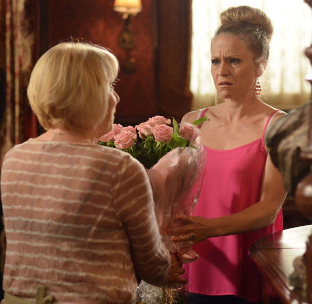 Pam delivers pink roses to a tense Linda