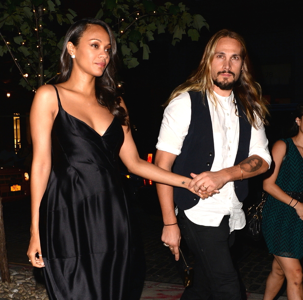 NEW YORK, NY - JULY 29: Actress Zoe Saldana and husband Marco Perego are seen in Soho on July 29, 2014 in New York City. (Photo by Raymond Hall/GC Images)