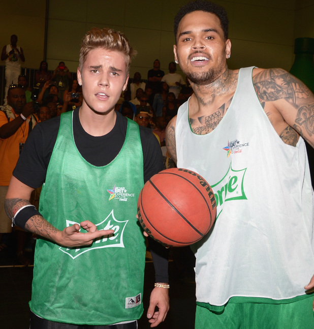 LOS ANGELES, CA - JUNE 28: Singers Justin Bieber (L) and Chris Brown attend the Sprite Celebrity Basketball Game during the 2014 BET Experience At L.A. LIVE on June 28, 2014 in Los Angeles, California. (Photo by Jason Kempin/BET/Getty Images for BET)