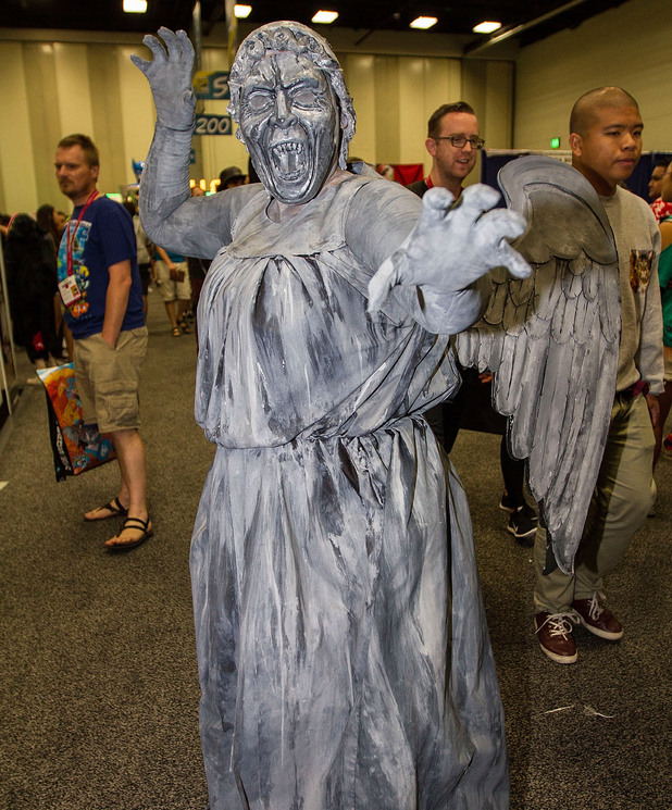 Caption:SAN DIEGO, CA - JULY 27: Costumed fan Toni Formalejo attends Comic-Con International dressed as a Weeping Angel from the BBC America TV show Doctor Who at San Diego Convention Center on July 27, 2014 in San Diego, California. (Photo by Daniel Knighton/WireImage)
