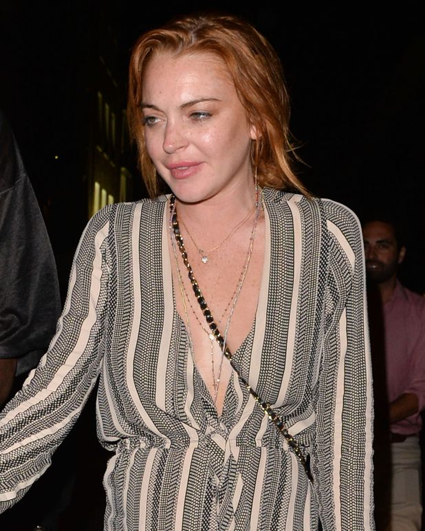 LONDON, UNITED KINGDOM - JULY 31: Lindsay Lohan and Vas J Morgan at Miabella night club on July 31, 2014 in London, England. (Photo by Mark Robert Milan/GC Images)