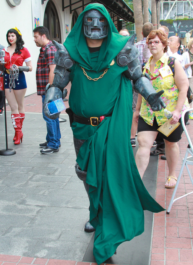 Caption:SAN DIEGO, CA - JULY 25: Cosplayers attend Comic-Con International 2014 on July 25, 2014 in San Diego, California Doctor Doom