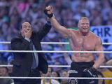 Paul Heyman with Brock Lesnar at WrestleMania 30