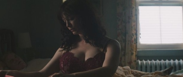 Christina Hendricks as Jeanie Scarpato in God's Pocket