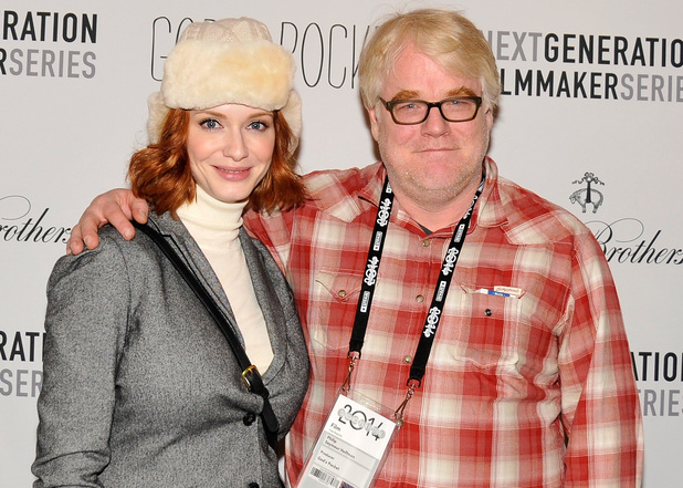 Christina Hendricks and Philip Seymour Hoffman attend the 'God's Pocket' premiere party during the 2014 Sundance Film Festival
