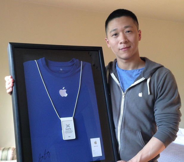 Sam Sung, former Apple employee, with his framed uniform and business card
