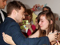 See Daniel Radcliffe comfort and cheer a sobbing fan at the launch of his new film.