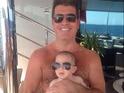 Simon Cowell adorns his baby son Eric with his trademark dark sunglasses.