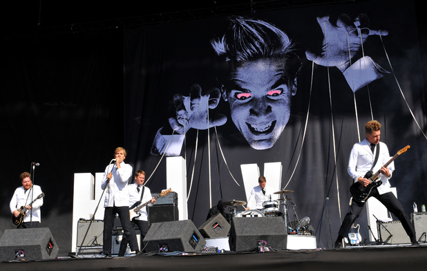 Howlin' Pelle Almqvist, Nicholas Arson, Vigilante Carlstroem, Dr. Matt Destruction and Chris Dangerous of The Hives perform on stage at the Reading Festival a