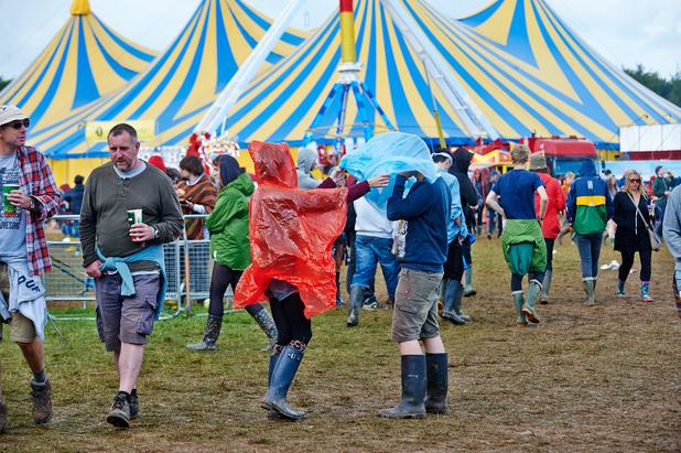 Festival goers endure heavy rain showers during the second day of Leeds Festival