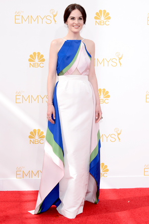 LOS ANGELES, CA - AUGUST 25: 66th ANNUAL PRIMETIME EMMY AWARDS -- Pictured: Actress Michelle Dockery arrives to the 66th Annual Primetime Emmy Awards held at the Nokia Theater on August 25, 2014. (Photo by Kevork Djansezian/NBC/NBC via Getty Images)